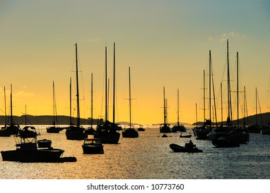 Crew members leave their boats as dusk approaches in the harbor in St. John, U.S. Virgin Islands
