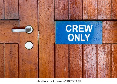 Crew only sign on a ship door