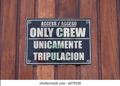 Crew only sign on wooden surface