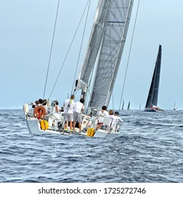 Crews sailing yachts at a sports regatta