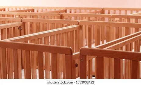 Cribs infant beds in maternity hospital or kindergarten day nursery