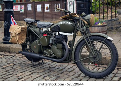 CRICH, ENGLAND - APRIL 17, 2017: A vintage military motorcycle at the World War II - Home Front 1940s event at the Crich Tramway Village in Derbyshire.