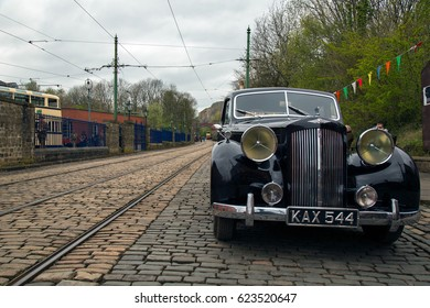 CRICH, ENGLAND - APRIL 17, 2017: Vintage Austin 125 car at the World War II - Home Front 1940s event at Crich Tramway Village in Derbyshire, UK, home of the National Tramway Museum.