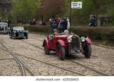 CRICH, ENGLAND - APRIL 17, 2017: Vintage Morgan car at the World War II - Home Front 1940s event at Crich Tramway Village in Derbyshire, UK, home of the National Tramway Museum.