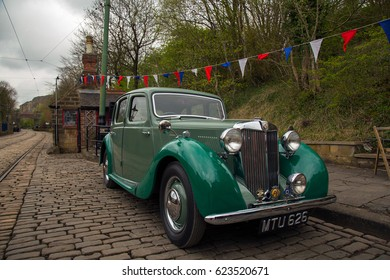 CRICH, ENGLAND - APRIL 17, 2017: Vintage MG car at the World War II - Home Front 1940s event at Crich Tramway Village in Derbyshire, UK, home of the National Tramway Museum.