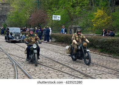 CRICH, ENGLAND - APRIL 17, 2017: The World War II - Home Front 1940s event at the Crich Tramway Village in Derbyshire, with historic road and military vehicles and people in 1940s costume.