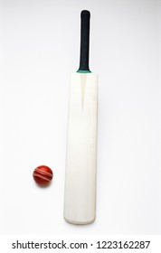Cricket ball and bat on white background