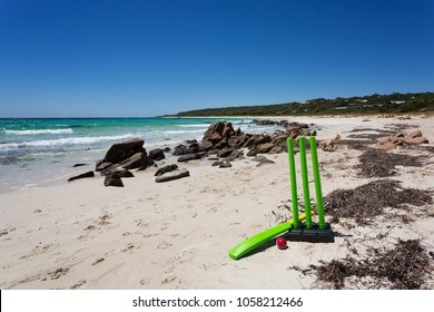 A Cricket bat and Ball on a beautiful beach in Western Australia.