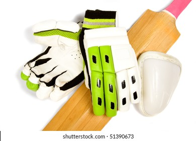 Cricket bat with bright pink handle, gloves and ball box on white.