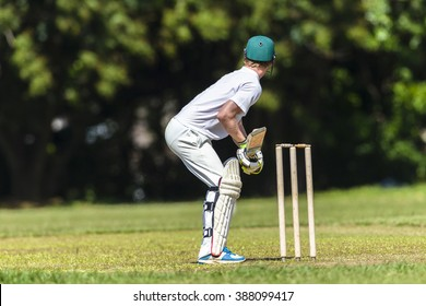Cricket Batman Ready Cricket game closeup player batting ready waiting ball to strike action high school teams.