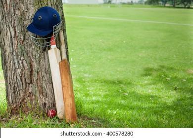 Cricket Equipment at cricket field,showcasing bats, balls, helmets and pads