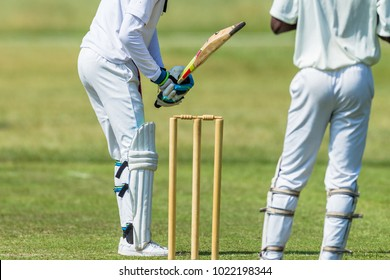 Cricket game action closeup unidentified abstract batsman wickets wicket keeper.