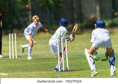Cricket Juniors Bowler Ball Batsman  Cricket junior game teenager player bowler action red ball batsman unidentified action
