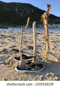 Cricket Stumps Made Out Of Three Sticks On The Beach With Thongs - Fitzgerald River National Park, Western Australia, Australia