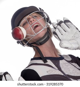 Cricketer wearing safety helmet being hit by a cricket ball