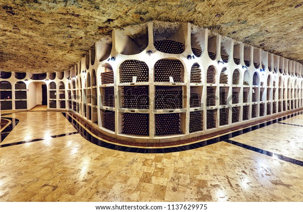 CRICOVA, MOLDOVA - OCTOBER 7, 2017: Famous wine cellars in wide perspective. Bright lights illuminating interior. Old stone ceiling