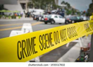 crime or accident scene sign do not pass the line with police cars in the background