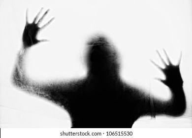 Crime background - silhouette of crying woman