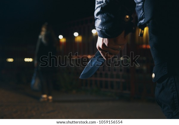 crime concepts robbery concepts a robber aimed his sharp knife at a woman to rob her valuable things in bag