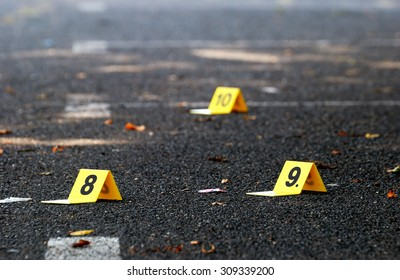 Crime Evidence Markers on Asphalt