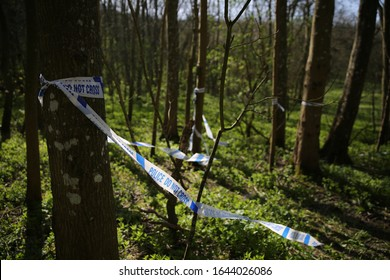 Crime scene behind police tape in the woods