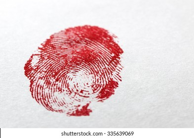 Crime Scene Concept - Dried Blood Fingerprint on White Paper
