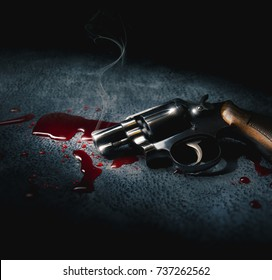 crime scene concept with a gun on a blood puddle  / high contrast image