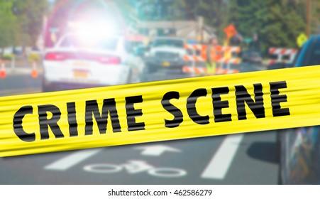 Crime scene cordon tape and emergency lights