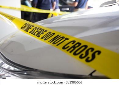 crime scene do not cross in vehicle crime scene