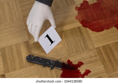Crime scene investigation, evidence markers on wooden flor with knife and blood. Murder, kill and forensic evidence concept
