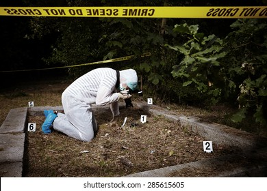 Crime scene investigation - photographer criminologist on place of crime
