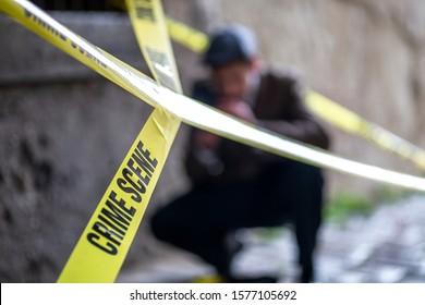 Crime scene, murder, investigation, bloody trail on asphalt, ongoing investigation, camera expert evidence of murder. Vinatge Detective