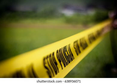 The crime scene, murder, investigation, police surrounded the scene with yellow ribbon that says stop police