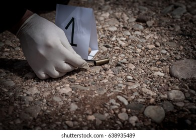 The crime scene, murder, investigation, sleeves shots serve as evidence, the investigation is done, the expert takes the capsule forceps and placed in the bag