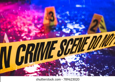 Crime scene on a rainy night with evidence markers, selective focus / high contrast image