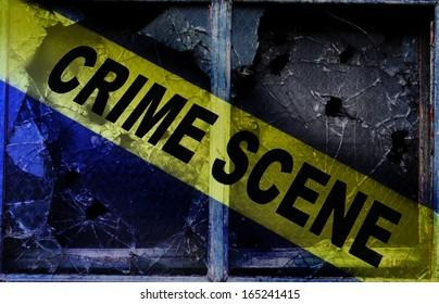 Crime Scene tape across shattered glass windows