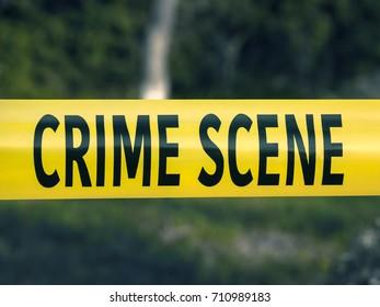 Crime scene tape closeup, police tape Do Not Cross outdoors
