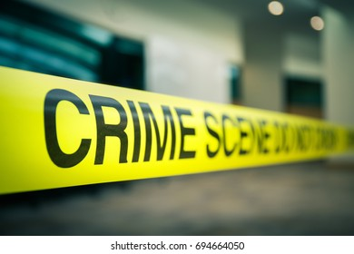 crime scene tape focus on word 'crime' in cenematic tone with copy space