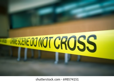 crime scene tape focus on word 'cross' in cinematic tone with copy space