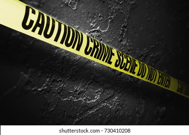 Crime scene tape with a grungy background /high contrast image