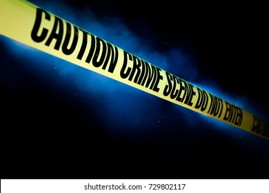 Crime scene tape with smoke on a black background