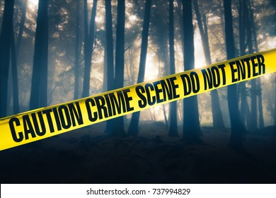 Crime scene tape in the woods