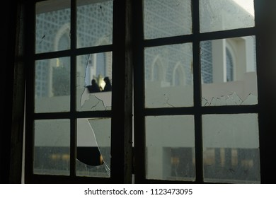 Crime Scene,  window with broken glass.