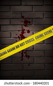Crime scene yellow cordon tape over brick wall with blood splatter on it