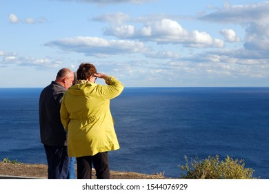 Crimea 21/09/2019 Group of older people travelling together. Looking at sea on sunny day.