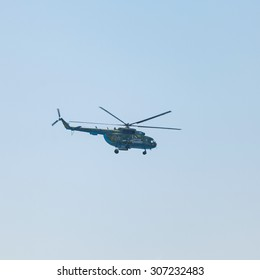 Crimea - 26 July 2015: parade in honor of the Day Russian Navy in Sevastopol. Flight MI-8 helicopter over the bay of the city