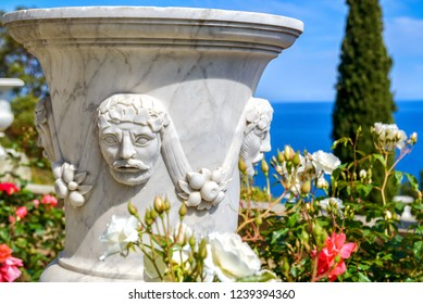 Crimea - May 20, 2016: Beautiful landscaped garden at the Vorontsov Palace in Crimea, Russia. This place is one of the main landmarks of Crimea. Marble sculpture among flowers on the Crimea sea coast.
