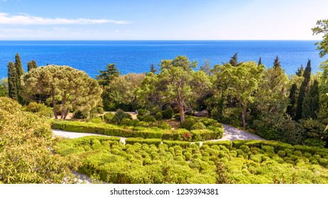 Crimea - May 20, 2016: Beautiful landscaped garden at the Vorontsov Palace in Crimea, Russia. This palace is one of the main landmarks of Crimea. Scenic panoramic view of the Crimea sea coast.