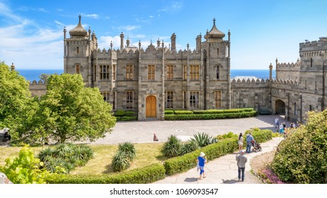 Crimea - May 20, 2016: People visit the Vorontsov Palace in the town of Alupka, Russia. Vorontsov Palace is one of the main tourist attractions of Crimea. Beautiful panoramic view of Crimea landmark.