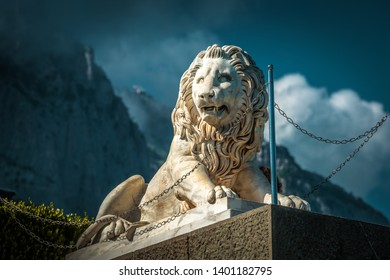 Crimea - May 20, 2016: Statue of lion at Vorontsov Palace on the background of misty Mount Ai-Petri in Crimea, Russia. It is a landmark of Crimea. Architecture and nature of Southern coast of Crimea.